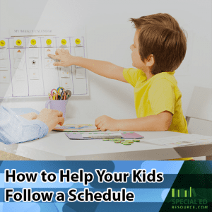 Boy looking at his schedule on a calendar with his mom at a table with text overlay How to Help Your Kids Follow a Schedule